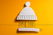 Image of a house wearing a beanie as insulation. Homepage.